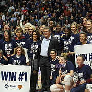 UNCASVILLE, CONNECTICUT- DECEMBER 19:  Head coach Geno Auriemma of the UConn Huskies with players past and present after recording his 1000th win as head coach of the team during the Naismith Basketball Hall of Fame Holiday Showcase game between the UConn Huskies Vs Oklahoma Sooners, NCAA Women's Basketball game at the Mohegan Sun Arena, Uncasville, Connecticut. December 19, 2017 (Photo by Tim Clayton/Corbis via Getty Images)