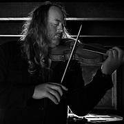 Carmel Bach Festival violinist Edwin Huzinga practices inside Robinson Jeffers' Tor House in Carmel, Calif. on July 3, 2018.
