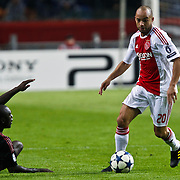 NLD/Amsterdam/20100928 - Champions Leaguewedstrijd Ajax - AC Milan, Demy de Zeeuw in duel met Clarence Seedorf