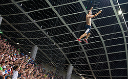 Fan of Slovenia climbing on the net behind a goal during the EURO 2016 Qualifier Group E match between Slovenia and England at SRC Stozice on June 14, 2015 in Ljubljana, Slovenia. Photo by Vid Ponikvar / Sportida