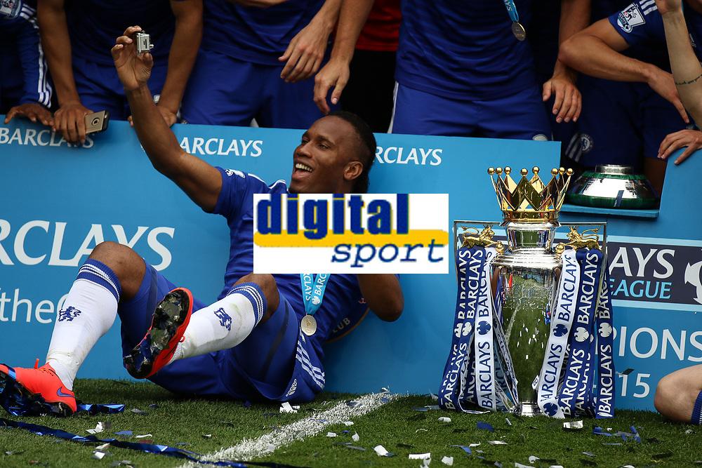 Football - 2014 / 2015 Premier League - Chelsea vs. Sunderland.   <br /> <br /> Chelsea's Didier Drogba with the Premier League Trophy at Stamford Bridge. <br /> <br /> COLORSPORT/DANIEL BEARHAM