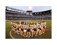 At the Melbourne Cricket Ground Greater Western Sydney and Richmond Tigers players stand together in silence post game in respect for former Adelaide Crows coach Phil Walsh who died earlier in the AFL season of 2015. (Copyright Michael Dodge/Getty Images)