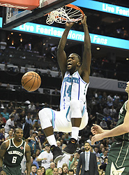 October 17, 2018 - Charlotte, NC, USA - The Charlotte Hornets' Michael Kidd-Gilchrist (14) dunks against the Milwaukee Bucks in the second half at the Spectrum Center in Charlotte, N.C., on Wednesday, Oct. 17, 2018. The Bucks won, 113-112. (Credit Image: © David T. Foster Iii/Charlotte Observer/TNS via ZUMA Wire)