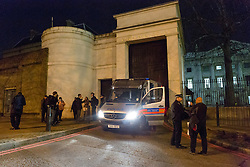 © Licensed to London News Pictures. 29/12/2015. London, UK. Police and protesters outside the Royal Mint building. Squatters have occupied the Royal Mint building, located opposite the Tower of London on the border of the City of London to protest against homelessness and highlight how empty buildings could provide shelter for rough sleepers. The site was previously used to manufacture British coins but is currently vacant and activists argue that this along with other vacant commercial buildings could be used to provide short term shelter for the homeless. Photo credit : Vickie Flores/LNP