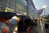 5/5/07 Omaha NE  People wait outside braving thunder storms at  Qwest Center Omaha just before the start of the Berkshire Hathaway annual meeting Saturday morning...(photo by Chris Machian/Prarie Pixel Group).