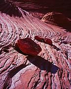 Navajo Sandstone boulders and intricate bedding pattern, Paria Canyon Vermilion Cliffs Wilderness, Utah.