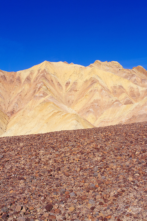 Morning light on eroded hills and rock field in Golden Canyon,  Death Valley National Park, California