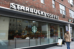 April 17, 2018 - New York City, New York, U.S. - A view of Starbucks, after it was announced that Starbucks will close 8000 stores for an afternoon on May 29, for racial-bias training after an incident in a Philadelphia Starbucks where two innocent  black men were racially profiled and arrested. (Credit Image: © Nancy Kaszerman via ZUMA Wire)