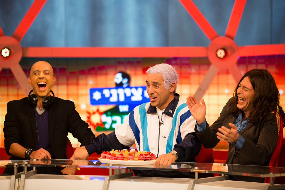 Israeli comic actor Mariano Idelman (C), who plays the role of Israeli Prime Minister Benjamin Netanyahu and Israeli comic actor Yuval Semo (R), who plays the role of Israeli Parliament Member Miri Regev of the Likud Party and Israeli comic actor Eli Finish (L), who plays the role of Israeli radio broadcaster Didi Harari, are seen during a filming of an episode of the top-rated Israeli satirical show 'Eretz Nehederet', Hebrew for 'Wonderful Country' at a television studio in Herzliya, Israel, on January 26, 2015.