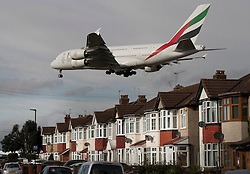 "© Licensed to London News Pictures. 27/10/2016. London, UK. An Emirates A380 Airbus comes into land over houses near Heathrow Airport. The government has announced that a third runway will be built at the United Kingdom's busiest airport. The Cabinet are divided - with Foreign Secretary Boris Johnson saying that the project is ""undeliverable"". Conservative MP for Richmond Zac Goldsmith has resigned. Photo credit: Peter Macdiarmid/LNP"