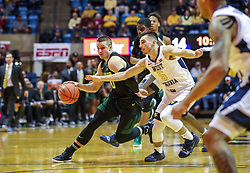 Jan 21, 2019; Morgantown, WV, USA; Baylor Bears guard Makai Mason (10) drives down the lane during the first half against the West Virginia Mountaineers at WVU Coliseum. Mandatory Credit: Ben Queen-USA TODAY Sports