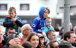Cardiff City fans in the crowd outside wait to get a glimpse of players arriving ahead of the match