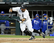 CHICAGO - APRIL 23:  Adam Eaton #12 of the Chicago White Sox bunts against the Texas Rangers on April 23, 2021 at Guaranteed Rate Field in Chicago, Illinois.  (Photo by Ron Vesely) Subject:  Adam Eaton