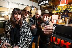 Motorcycle customizer Mr. Martini (Nicola Martini) at his bar-restaurant-shop party with Easyriders' Magazine new publisher Pepper Foster (R) and Michael Paradise at Motor Bike Expo (MBE) bike show. Verona, Italy. Thursday, January 16, 2020. Photography ©2020 Michael Lichter.