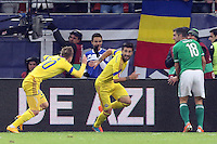 ROMANIA, Bucharest: Romania's Paul Papp (C) celebrates after scoring his second goal during the Euro 2016 Group F qualifying football match Romania vs Northern Ireland in Bucharest, Romania on November 14, 2014.
