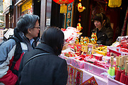 Shop on Gerrard Street in preparation for the upcoming Chinese New Year celebrations in Chinatown in London, England, United Kingdom.