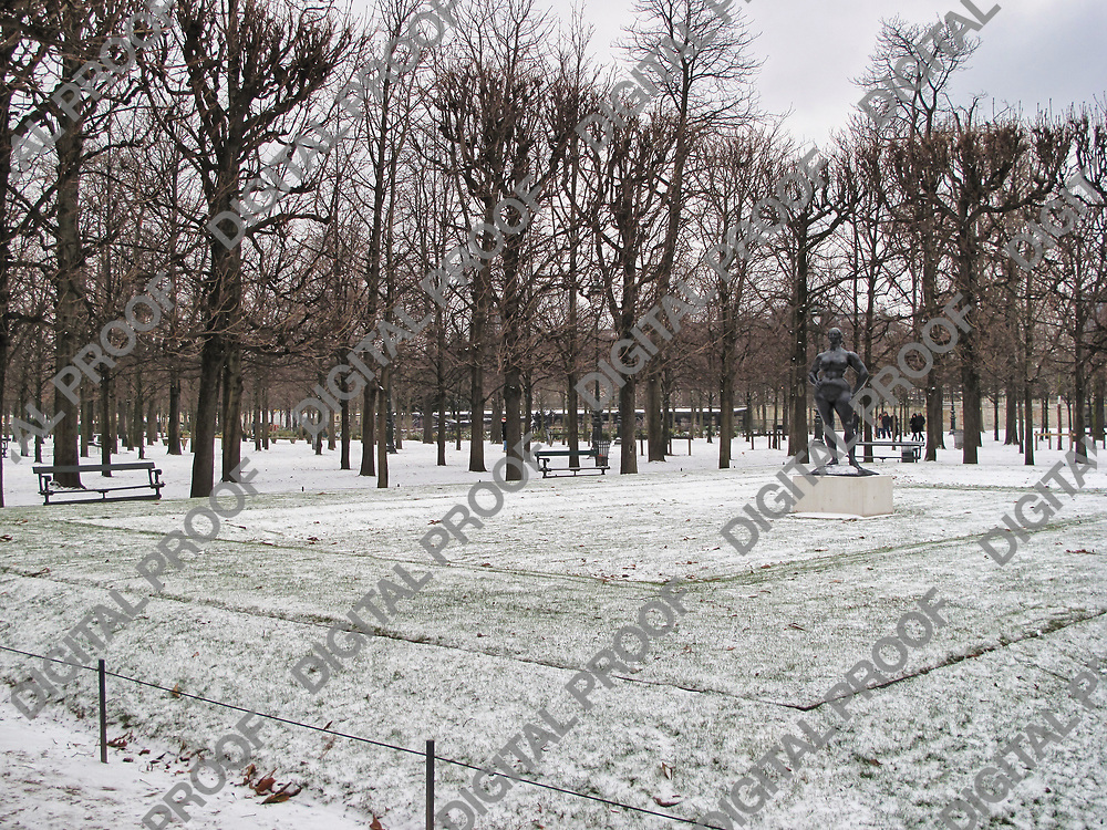 Tuileries Garden with snow during winter season with the statue of standing woman of Gaston Lachaise, Paris, France