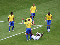 Photo: Chris Ratcliffe.<br /> Brazil v Ghana. Round 2, FIFA World Cup 2006. 27/06/2006.<br /> Brazil defence surround a Ghana player.