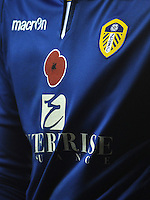 The shirt Leeds United's Marco Silvestri displaying a poppy in honour of Remembrance Day<br /> <br /> Photographer Kevin Barnes/CameraSport<br /> <br /> Football - The Football League Sky Bet Championship - Leeds United v Blackpool - Saturday 8th November 2014 - Elland Road - Leeds<br /> <br /> © CameraSport - 43 Linden Ave. Countesthorpe. Leicester. England. LE8 5PG - Tel: +44 (0) 116 277 4147 - admin@camerasport.com - www.camerasport.com