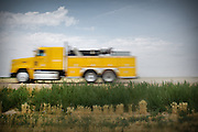 "Life of custom harvesters: custom harvesting or custom combining is the business of harvesting of crops for others. Custom harvesters usually own their own combines and work for the same farms every harvest season. Custom harvesting relieves farmers from having to invest capital in expensive equipment while at the same time maximizing the machinery's use. .Harvesters travel North to South through the US, living in trailers, following the season, usually hiring overseas seasonal workers in need of improving their harvesting experience on very large combines (harvesting machines)...A 4-weeks road trip across the USA, from New York to San Francisco, on the steps of Jack Kerouac's famous book ""On the Road"".  Focusing on nomadic America: people that live on the move across the US, out of ideology or for work reasons."