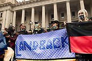Protesters have been marching and holding up placards peacefully through the city in groups of 100 as part of an Invasion Day rally. The Australia Day protest went ahead despite coronavirus rules limiting gatherings to 100 people. (Photo by Michael Currie/Speed Media)