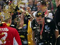 Håndball<br /> VM Tyskland<br /> 04.02.07<br /> Finale <br /> Tyskland - Polen<br /> Tyskland Verdensmester<br /> Florian Kehrmann duscht Trainer Heiner Brand Deutschland mit Champagner<br /> DIGITALSPORT / NORWAY ONLY