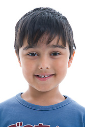 Portrait of a little boy smiling in the studio,