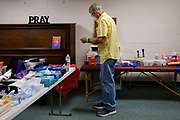 """26 JUNE 2021 - DES MOINES, IOWA: Dr. JAMES YOUNG, M.D., checks the inventory of medical supplies during the RAM clinic in Des Moines, Saturday, June 26. Remote Area Medical (RAM) is a nonprofit provider of free pop-up clinics. Their mission is to prevent pain and alleviate suffering by providing free, quality healthcare to those in need. They do this by delivering free dental, vision, and medical services to underserved and uninsured individuals. The clinic in Des Moines was RAM's first clinic in Iowa. RAM was hoping to see 250 people during the two day """"pop up"""" clinic.      PHOTO BY JACK KURTZ"""