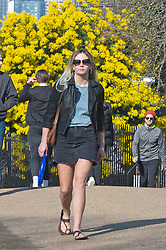© Licensed to London News Pictures 27/02/2021.        Greenwich, UK. A woman wearing sunglasses out and about during a third national Coronavirus lockdown enjoying the sunny weather in Greenwich Park, London. Photo credit:Grant Falvey/LNP