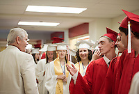 Principal Jim McCollum takes a few moments with his first graduating class of Laconia High School prior to their 135th commencement ceremony for Laconia High School Saturday morning.  (Karen Bobotas/for the Laconia Daily Sun)