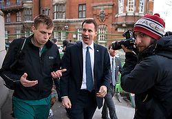 © Licensed to London News Pictures. 11/02/2016. London, UK. Secretary of State for Health JEREMY HUNT being confronted by Junior doctor DAGAN LONSDALE (correct spelling),  a registrar in intensive care, while in westminster today (11/02/2016). Hunt today announced that he will force through a new junior doctors contract against their will Photo credit: Ben Cawthra/LNP