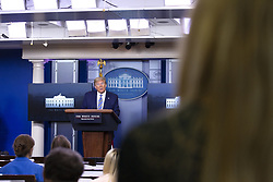 United States President Donald J. Trump, joined by United States Vice President Mike Pence, takes a question from an OAN (One America News) reporter during a news conference in the James S. Brady Press Briefing room at the White House in Washington D.C., U.S., on Sunday April 19, 2020. Speaker of the United States House of Representatives Nancy Pelosi (Democrat of California) stated that lawmakers are close to a deal with United States Secretary of the Treasury Steven T. Mnuchin regarding a second round of small business loans for businesses impacted by Coronavirus. Credit: Stefani Reynolds / CNP