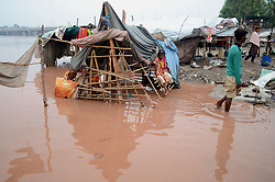 July 21, 2017 - Lahore, Punjab, Pakistan - Pakistani gypsy families live in makeshift shelters established on the bank of Ravi River as water entered into their makeshift shelters  due to increase water level in the river after recent spell of heavy monsoon. (Credit Image: © Rana Sajid Hussain/Pacific Press via ZUMA Wire)