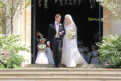 Newlyweds Thomas Kingston and Lady Gabriella Windsor walk down the steps of the chapel fter their wedding at St George's Chapel in Windsor Castle.