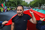 """Demonstrators Afghanistan national flag and shout anti-Taliban slogans during a protest """"Save Afghanistan"""" near Marble Arch in central London against the Taliban on Saturday, Aug 21, 2021. (VX Photo/ Vudi Xhymshiti)"""