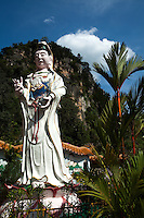 Sam Poh Tong cave temples = these picturesque structures embedded within the high limestone caves and cavities located near Gunung Rapat just outside Ipoh are a sight to behold.  There are impressive works of art, with statues of Buddha in various forms among natural stalactities and rock formations.