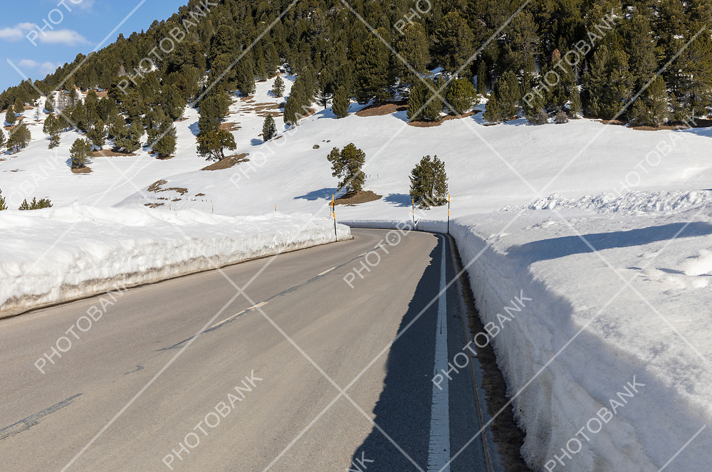 Clean road with lots of snow on the side of Lukmanier in Ticino, on the Swiss Alps. Nobody inside