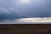 A tanker breaks out of the rain passing through the English Channel past Dungeness in Kent on the 28th of December 2021 in Dungeness, United Kingdom.