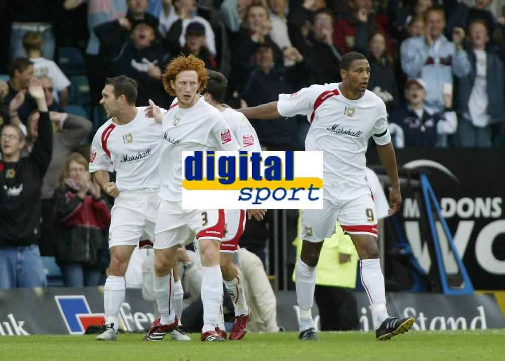 Photo: Marc Atkins.<br /> <br /> Milton Keynes Dons v Notts County. Coca Cola League 2. 02/09/2006. Scott Taylor (L) of MK Dons celebrates with teamates after scoring.
