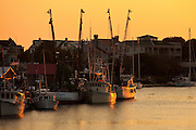 Sunset over Shem Creek shrimp boats in Mount Pleasant, SC