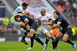 Owen Farrell (England) is upended in a tackle - Photo mandatory by-line: Patrick Khachfe/JMP - Tel: Mobile: 07966 386802 09/11/2013 - SPORT - RUGBY UNION -  Twickenham Stadium, London - England v Argentina - QBE Autumn Internationals.