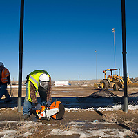 011813       Brian Leddy<br /> Construction workers with RMCI General Contractors tear down a fence at the Gallup Sports Complex Friday morning. The city is in the process of remodeling the facility, with a new football/soccer field planned as well as turf on all the softball fields.