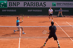 May 30, 2018 - Paris, Ile-de-France, France - Márton Fucsovics of Hungary and Marco Cecchinato of Italy returns the ball to Lukasz Kubot of Poland and Marcelo Melo of Brazil during the second round at Roland Garros Grand Slam Tournament - Day 4 on May 30, 2018 in Paris, France. (Credit Image: © Robert Szaniszlo/NurPhoto via ZUMA Press)