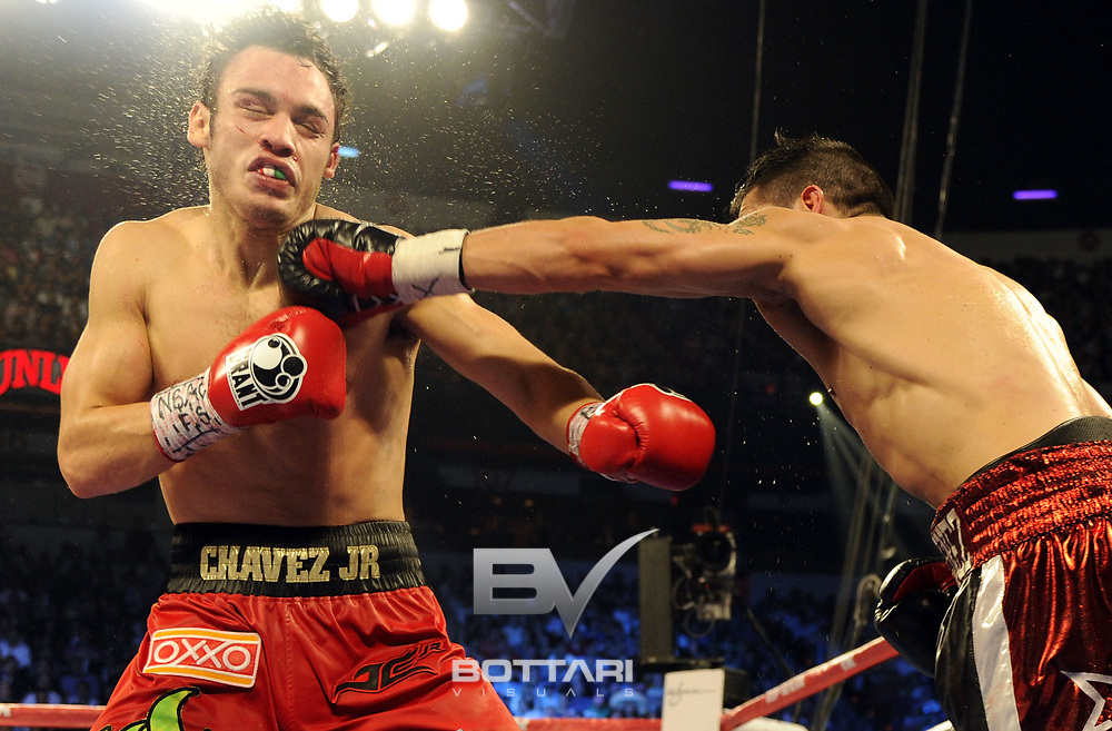 LAS VEGAS, NV - SEPTEMBER 15: Sergio Martinez (R) lands a left to the chin of Julio Cesar Chavez Jr. in the tenth round of their WBC middleweight title fight at the Thomas & Mack Center on September 15, 2012 in Las Vegas, Nevada.  (Photo by Jeff Bottari/Getty Images)