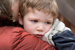 Grandmother hugging young boy,