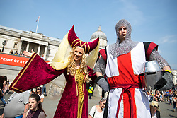 © Licensed to London News Pictures. 21/04/2018. London, UK. Revellers attend the 'Feast of St George' event in Trafalgar Square, to celebrate the Patron Saint of England. St George's Day is on 23 April. Photo credit : Tom Nicholson/LNP