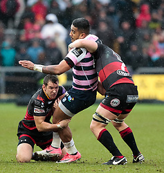 Cardiff Blues' Rey Lee-Lo is tackled by Dragons' Adam Warren and Aaron Wainwright<br /> <br /> Photographer Simon King/Replay Images<br /> <br /> Guinness Pro14 Round 11 - Dragons v Cardiff Blues - Tuesday 26th December 2017 - Rodney Parade - Newport<br /> <br /> World Copyright © 2017 Replay Images. All rights reserved. info@replayimages.co.uk - www.replayimages.co.uk