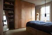 The master bedroom in architect Simon and Taeko Astridge's newly renovated Tufnell Park neighborhood London flat. CREDIT: Vanessa Berberian for The Wall Street Journal. BALANCE SHEET - Astridge