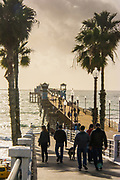 Tourists Walking On The Oceanside Pier