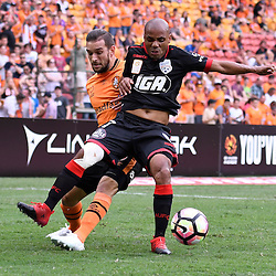 BRISBANE, AUSTRALIA - DECEMBER 11: Jack Hingert of the Roar and Henrique of Adelaide United compete for the ball during the round 10 Hyundai A-League match between the Brisbane Roar and Adelaide United at Suncorp Stadium on December 11, 2016 in Brisbane, Australia. (Photo by Patrick Kearney/Brisbane Roar)